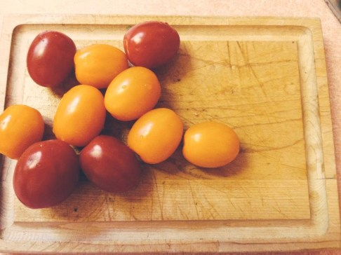 Multi colored cherry tomatoes are a must for this particular pizza. You want lots of color.