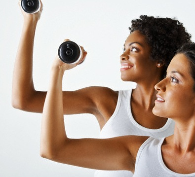 ladies holding arm weights