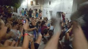The crowd gets down on the floor during the band playing, waiting for the climax of the song