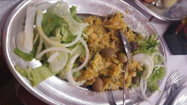 Bacalhau mixed with potato and onion and egg