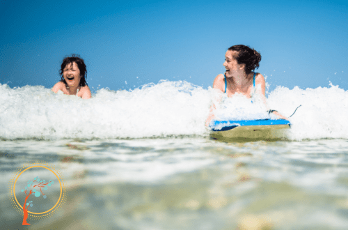 mother and child bodyboarding