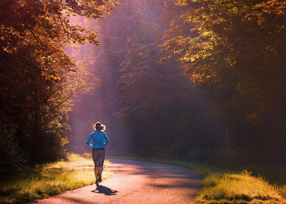 woman running in autumnal setting