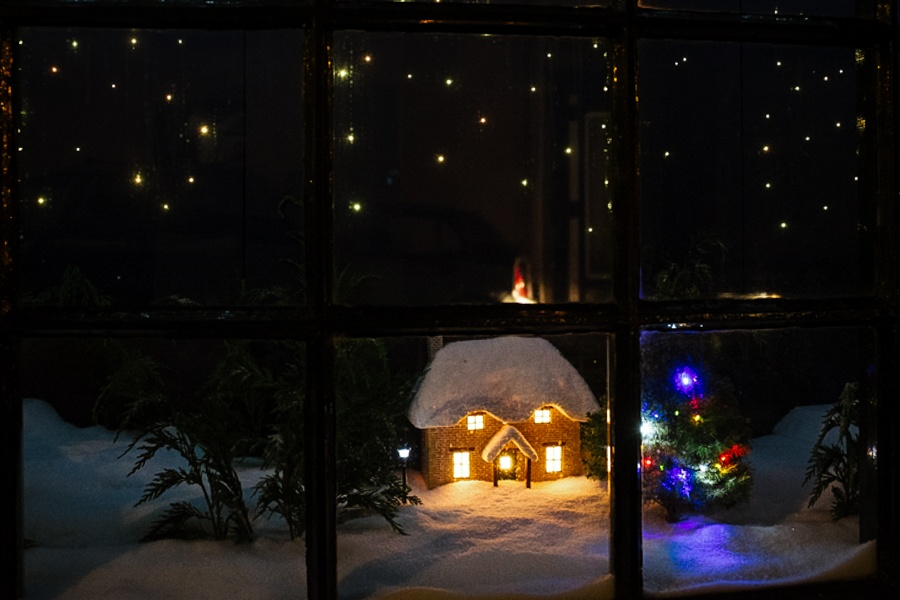 Christmas window display of a snow covered landscape and house