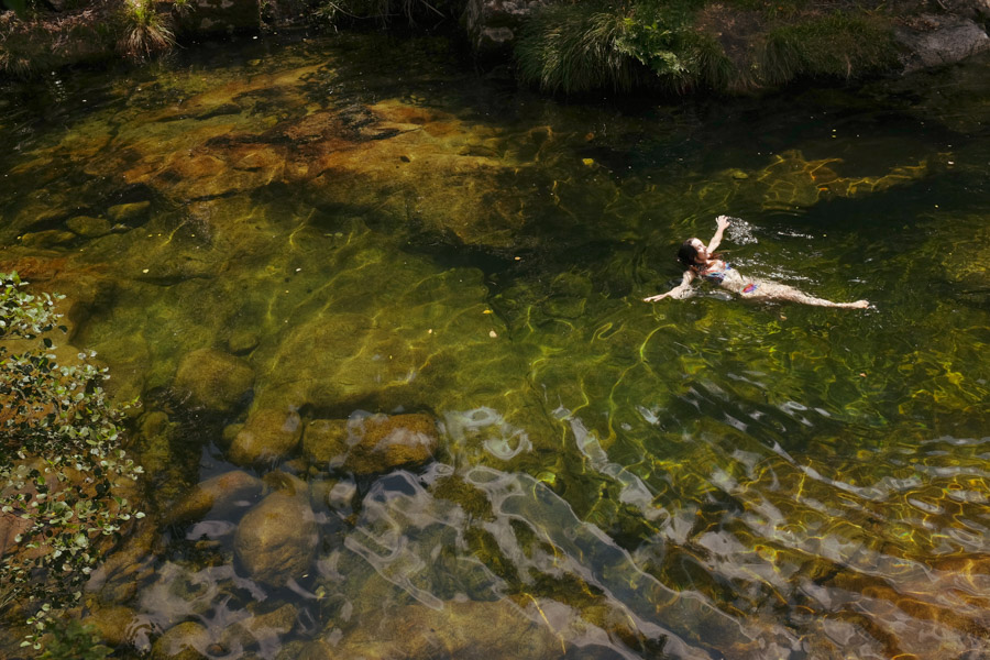 image of a woman swimming in a river