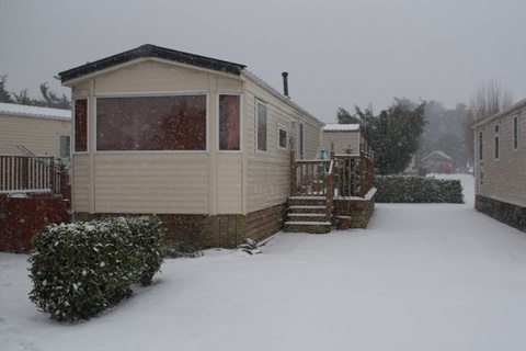 image of a static caravan in the snow