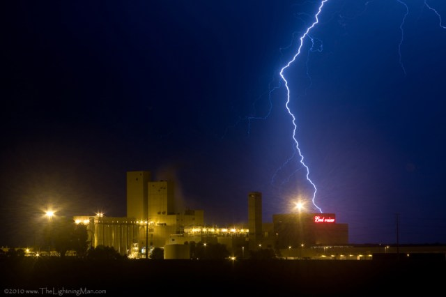 Lightning bolt striking behind budweiser.