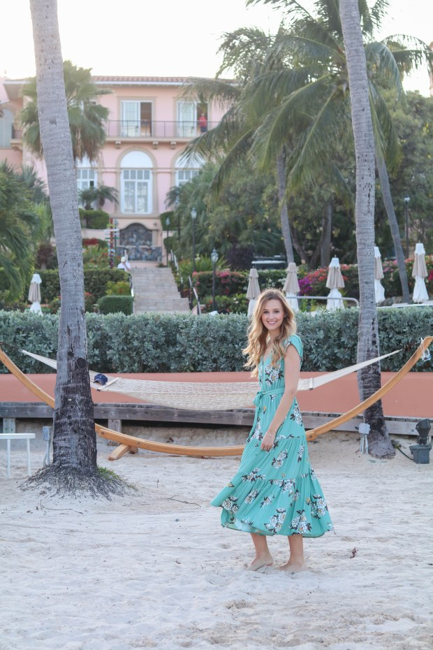 Fashion blogger, Leigha Gardner, of The Lilac Press wearing a Free People floral maxi dress at the beach in St. Thomas.