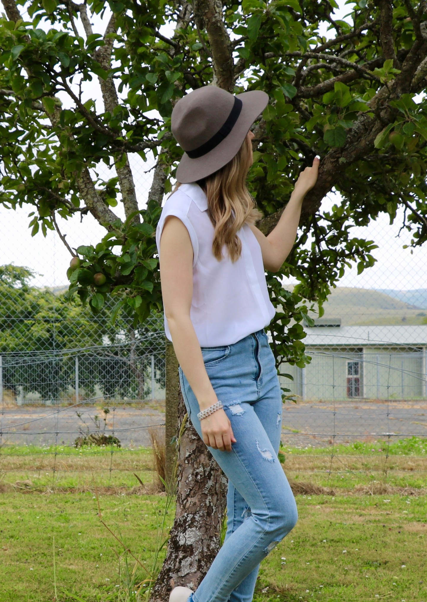 Styling distressed denim for summer