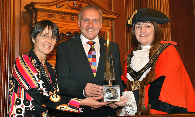 Lincoln Mayor Councillor Karen Lee presents the Lincoln Civic Award to Running Imp International's directors Caroline Birkin and Chris Illsley.