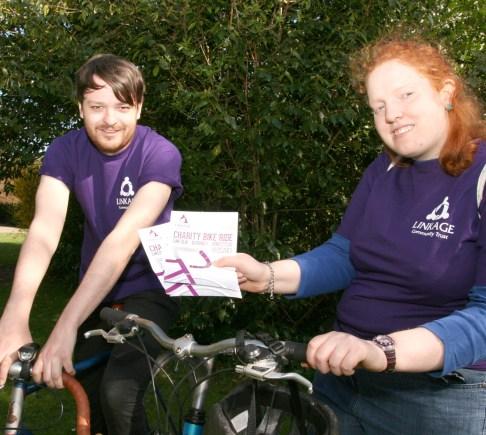 Linkage employee Luke Bell and service user Tanya Studd prepare for the bike ride