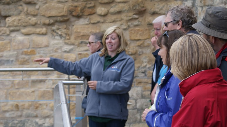 Castle Wall Project Co-ordinator and Stone Conservator Jane Harrison guides visitors around the walls.