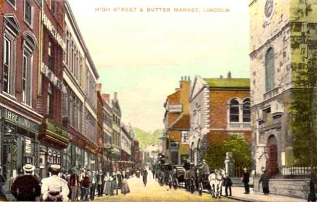 An old image of Lincoln High Street and Butter Market.