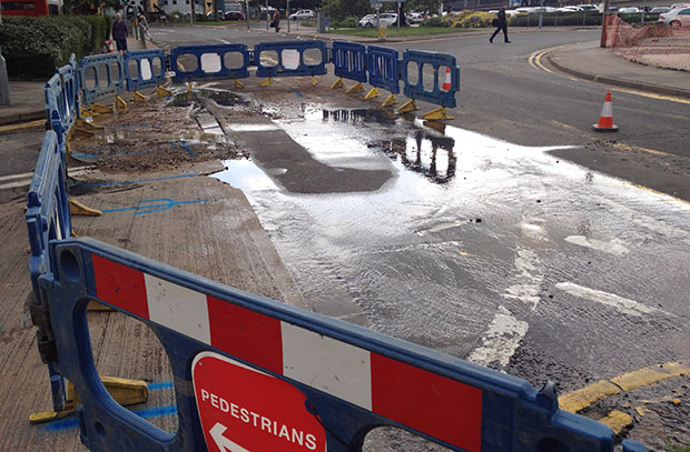 The scene at 10.30am. Engineers have managed to block the leak, meaning less water on the road.