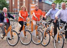On their bikes (L-R): City of Lincoln Mayor Patrick Vaughan, Access LN6 Project Manager Chantelle Grundy, County Councillor Richard Davies, Hourbike MD Tim Caswell and Matt Corrigan from Lincoln BIG. Photo: Steve Smailes for The Lincolnite