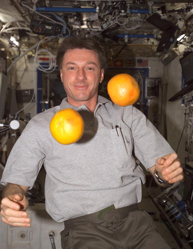 "Michael Foale, Expedition 8 commander and NASA ISS science officer, ""juggles"" fresh fruit in the Destiny laboratory of the International Space Station (ISS) in 2004. Photo: NASA"