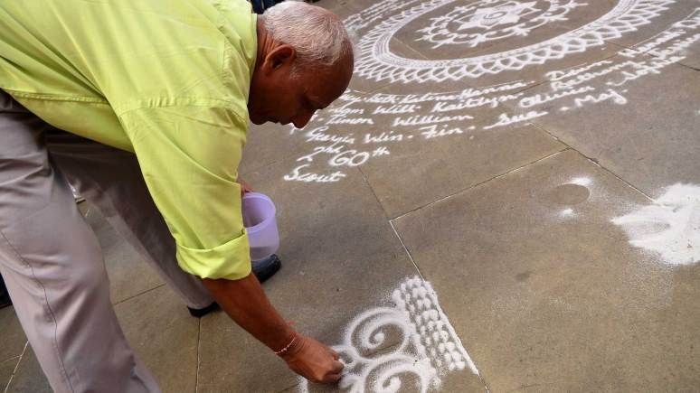 Janak Chauchan is a Rangoli artists often seen in the summer in uphill Lincoln. Photo: Steve Smailes for The Lincolnite