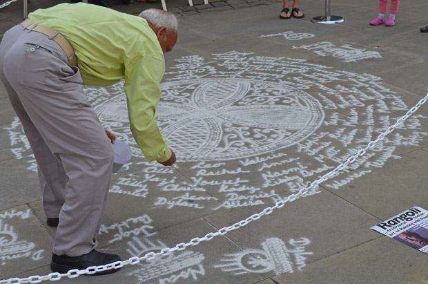 Janak Chauchan uses marble power for his street art, which washes away in the rain. Photo: Dale Benton for The Lincolnite
