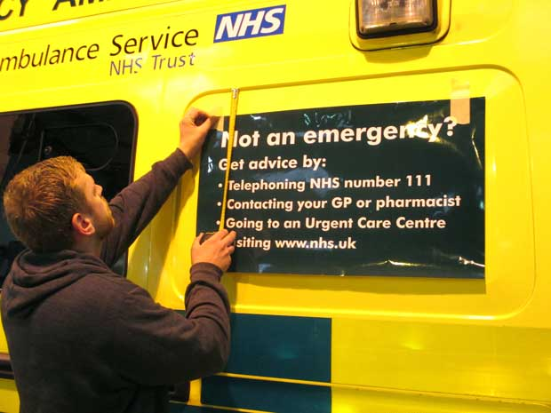 The correct use of the 999 number is highlighted on local ambulances.