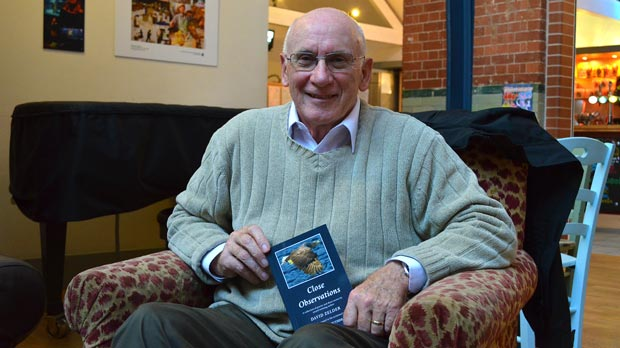 David Zelder with his new book Close Observations. Photo: Emily Norton for The LIncolnite