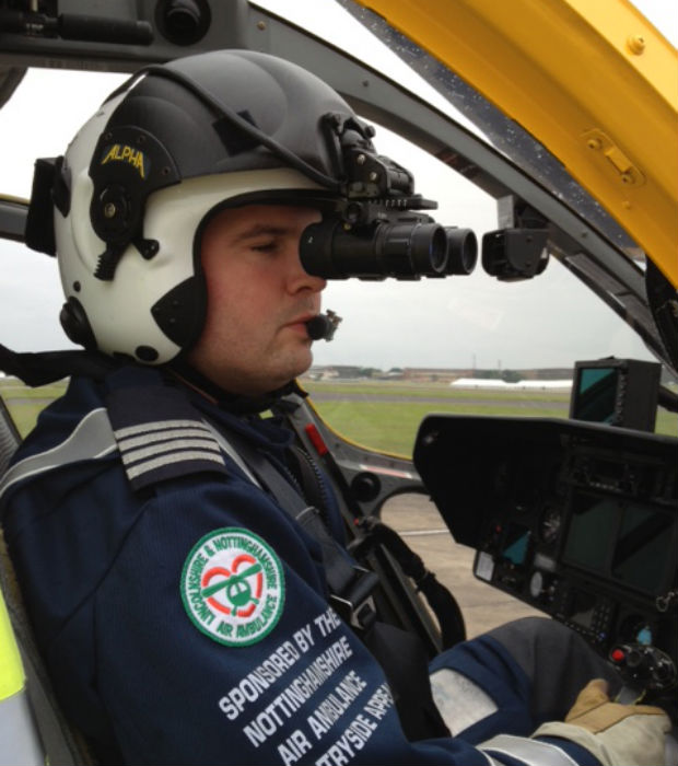 Captain Tim Taylor uses the night vision goggles. Photo: Lincolnshire and Nottinghamshire Air ambulance.