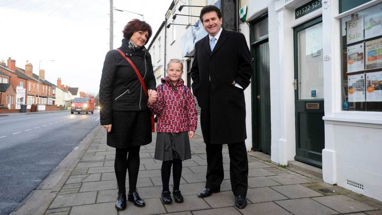 Chief Executive of City of Lincoln Council Andrew Taylor walks along Burton Road with Sophie (centre) and her mum, Karen. Photo: Stuart Wilde