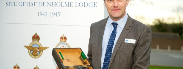 William Far School Headteacher Andy Stones with the donated compass.