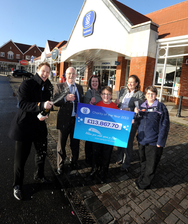 Lincolnshire Co-op's Member Engagement Manager Richard Whittaker, Lincolnshire Co-op's President Malcolm Hoskins, Emma Smith, Callum Smith, 11, When You Wish Upon A Star's Regional Fundraising Manager Joanne Heywood and Lincolnshire Co-op's Birchwood Community Liaison Representative Jo Richardson. Photo: Lincolnshire Co-op