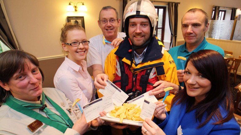 Elite Fish & Chips awarded cheques worth £5,000 to five winning charities. Photo: Richard Addison