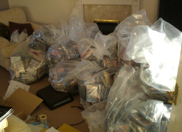 The fake DVDs in the man's living room. Photo: Lincolnshire Trading Standards