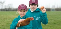 North Scarle Primary School pupils, from left, Fecility Jane Lloyd, 10, and Sean McEneny, 9, at the Happy Egg Company in Beckingham. Photo: Chris Vaughan