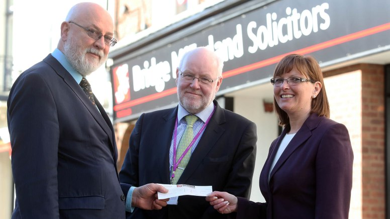 Patrick Purves (left) presents a cheque for £355 to the Chief Executive of the Linkage Community Trust, Ges Roulstone and fund-raising manager, Julie Stubbs from money raised for Charity Will Month. Photo: David Moss