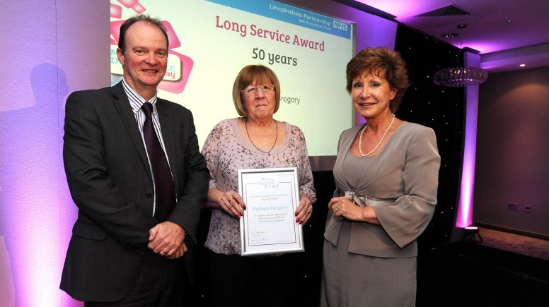 Barbara Gregory was praised for over 50 years of NHS service. She received the award from Trust interim chief executive, John Brewin and Trust chairman, Eileen Ziemer.