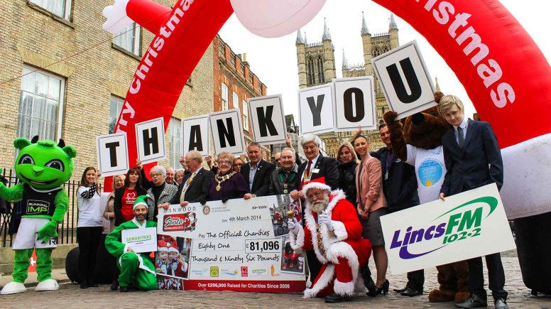 Organisers and sponsors of the 2013 Lincoln Santa Fun Run and Walk met charities on Castle Hill to present the £81k cheque. Photo: Running Imp