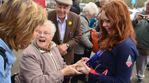 People at Sainsbury's in Lincoln were excited to meet Jade and hold her medals. Photo: Steve Smailes for The Lincolnite