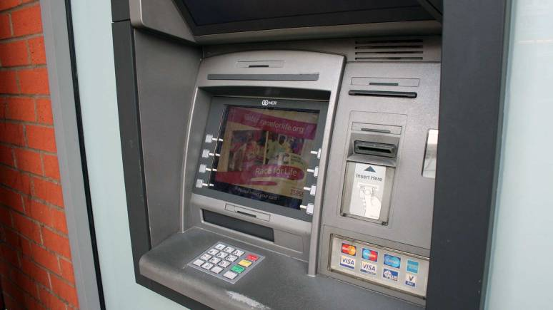 The cash machine outside Tesco Express on Lincoln High Street, which has now been fixed after it was tampered with.