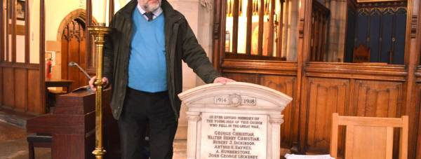 Dr Charles Shaw, local minister at St Faith's and Below Hill Federation with the memorial plaque.