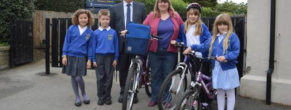 Mr Jeffery Day, Headteacher at Swinderby Primary School with pupils and parents walking and cycling to school for the LN6 Golden Boot Challenge. Photo: LCC