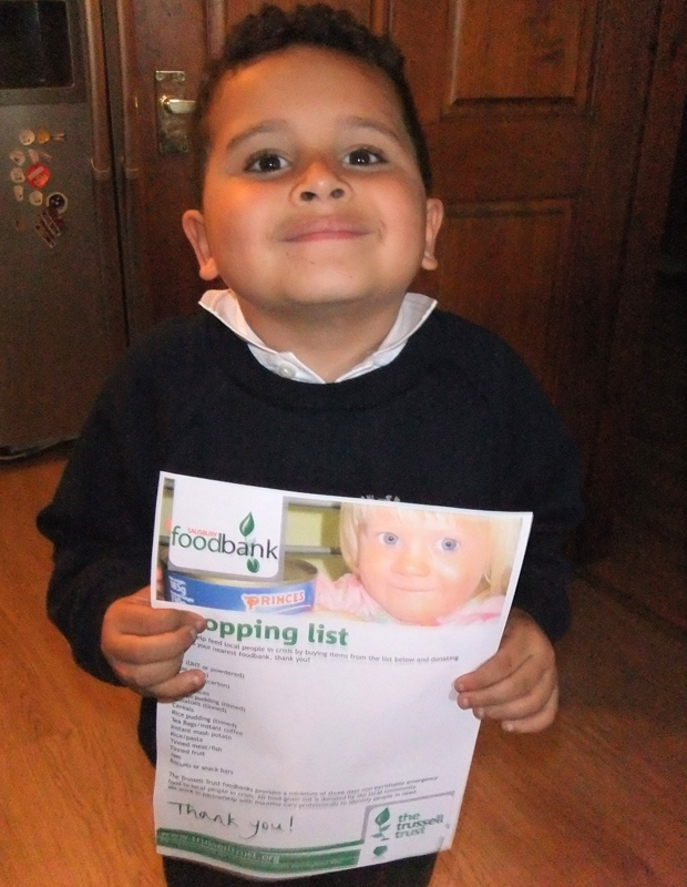 Theo receiving an official shopping list from the Trussell Trust.