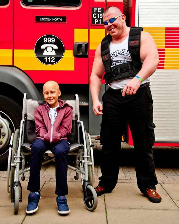 Dave Johnson pulled a 16-tonne fire engine for Ethan's charity in 2013.