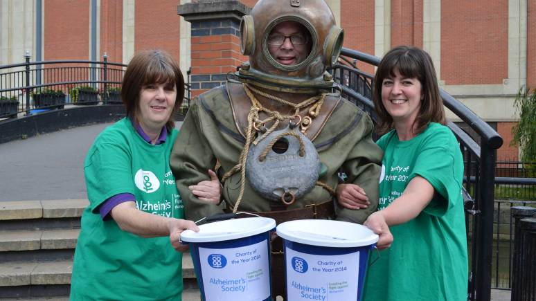 Lincolnshire Co-op Customer Sales Assistant Jayne McDougall, City Square Food Store Manager Phil Goddard and Lincolnshire Co-op's City Square Coffee Shop Manager Debbie Wright (who owns the diving suit). Photo: Lincolnshire Co-op