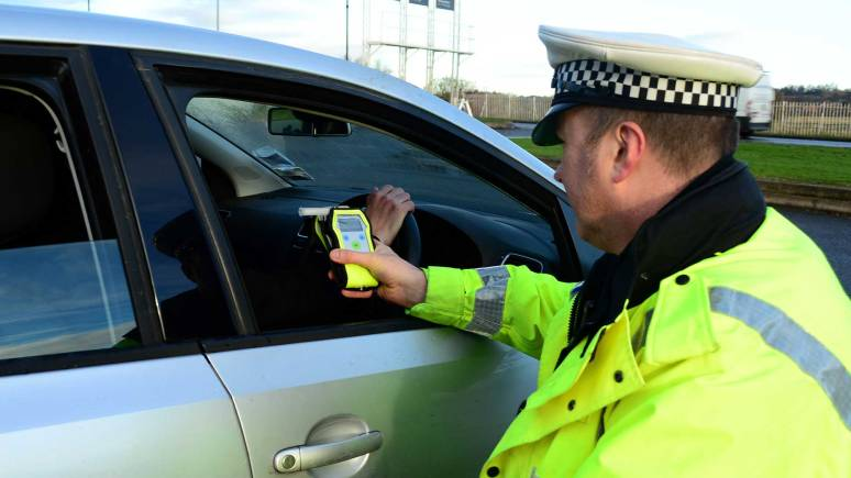 Lincolnshire Police officer carries out a breathalyser test in Lincoln. Photo: Steve Smailes for The Lincolnite
