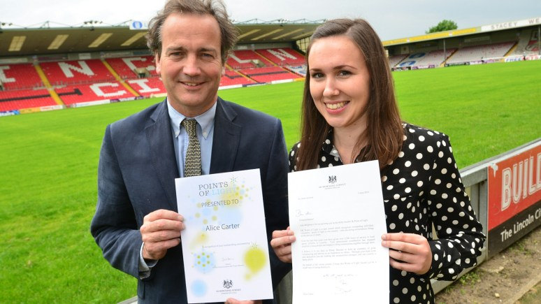 Minister for Civil Society Nick Hurd awarding volunteer Alice Carter (22) with her Points of Light Award. Photo: Steve Smailes for The Lincolnite