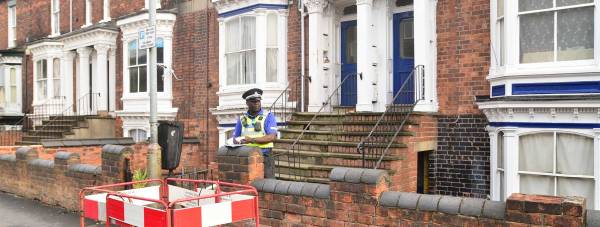 PCSO Horace Squire guarding the scene on Portland Street in Lincoln. Photo: SS/The Lincolnite