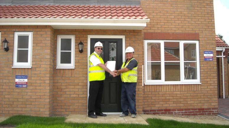 WLDC building control surveyor, Patrick Warner and Taylor Lindsey site manager Tony Robinson .