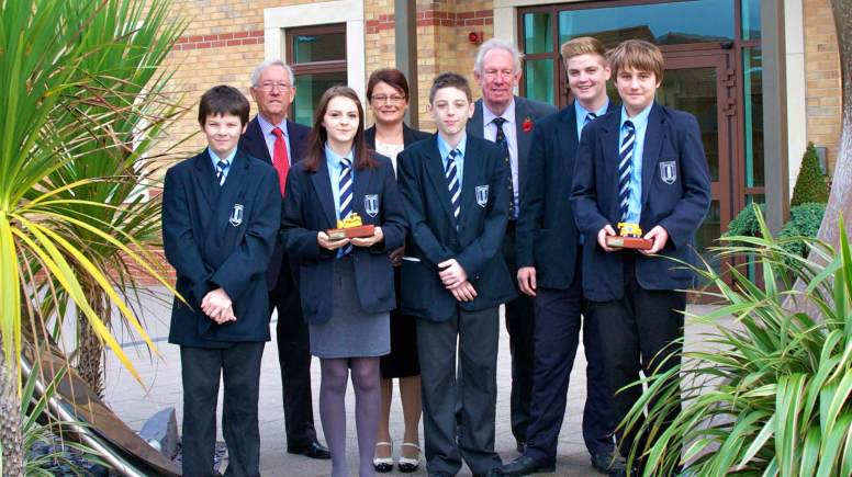 Priory Witham pupils receiving their award from Herman Kok and Clive Hall of the LGTA.