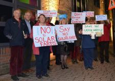 The group of 12 local residents protested before the planning meeting in objection to the proposed solar farms.