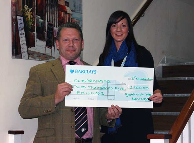 Karl hands over cheque to St Barnabas Hospice Lincolnshire.