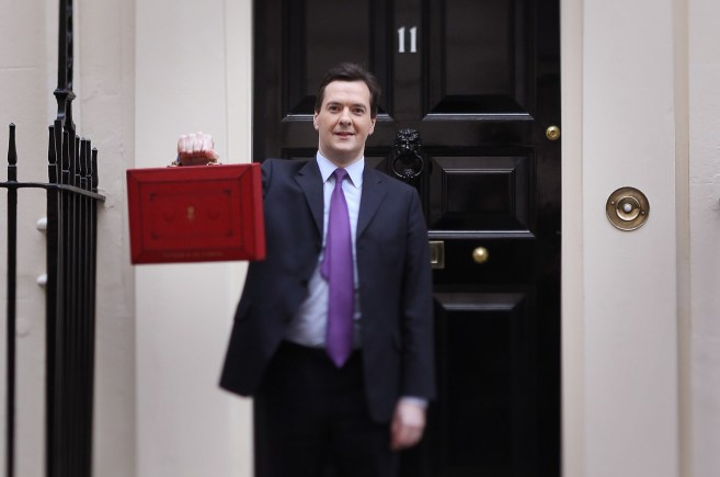 Chancellor George Osborne  holding the Budget suitcase