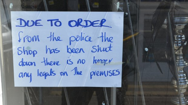 Signs have been displayed in the windows of the now empty shop.