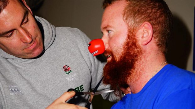 Lincoln Castle Academy teacher Andrew Thomas having his beard cut off for Red Nose Day